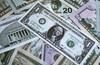 Доларът под натиск заради мрачни перспективи пред икономиката на САЩ